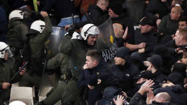 Greek riot police clash with Ajax fans in Athens.