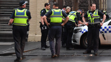Police investigate the scene where a body was found on Celestial Avenue in the CBD on Wednesday.