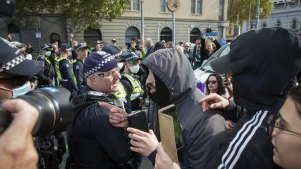 Violence has broken out into the streets between police and protestors at an anti-lockdown rally at Parliament House, Melbourne.