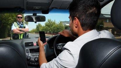 New roadside tech to warn Queensland drivers to stop using phones