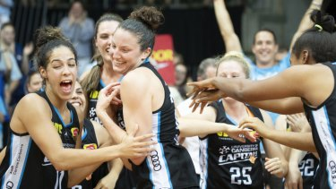 Canberra Capitals teammates cheer their co-captain Kelsey Griffin. Photo: Sitthixay Ditthavong