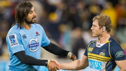 Creating change: David Pocock and Jacques Potgieter shake hands a year after Pocok called out the Waratahs player for a homophobic slur.