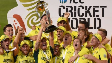 Home heroes: Michael Clarke holds up the 2015 trophy after Australia beat New Zealand in the World Cup final at the MCG