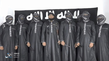 Image from Islamic State that purports to show Mohammed Zahran, or Zahran Hashmi, centre, who Sri Lanka says led the Easter Sunday attacks.