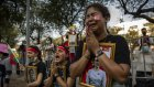 Myanmar nationals gathered outside the United Nations headquarters in Bangkok to call for action against the military over the deaths of protesters.