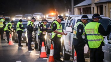 NSW Police stop and question drivers at a checkpoint on the NSW-Victoria border in Albury last year.