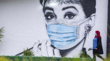 Street art in Moorabin depicting the iconic photo of Audrey Hepburn in Breakfast At Tiffany's wearing a mask.