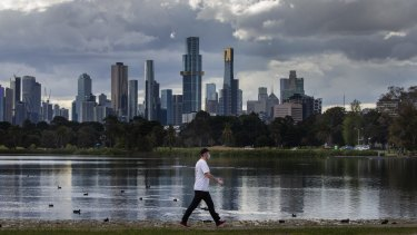 Stormy skies are seen over Melbourne from Albert Park Lake.  Photograph by Paul Jeffers The Age NEWS 29 Aug 2021