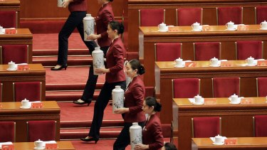 Attendants serve tea ahead of the opening of the 19th National Congress of the Communist Party of China at the Great Hall of the People in Beijing, China, on Wednesday, Oct. 18 2017. Chinese President?Xi Jinping warned of ?severe? challenges, as he kicked off a twice-a-decade party meeting that may signal if he will appoint a successor to rule after 2022. Photographer: Qilai Shen/Bloomberg