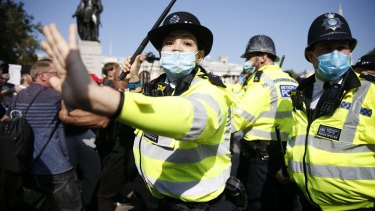 Protestors clash with police during an Anti-Vax rally at Trafalgar Square at the weekend.