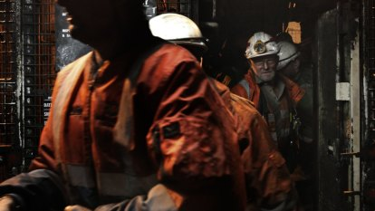 Miles underground, sleeping at work: How miners try to dodge the virus