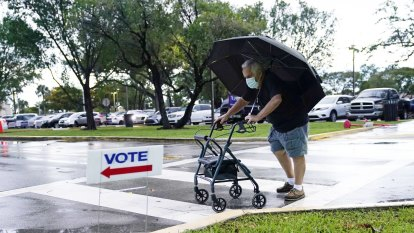 Republicans, Democrats turn out equally on Florida's first day of voting