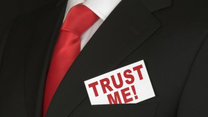 Can other people be trusted? It depends on your education and your bank balance