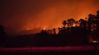 Blaze burns near power plant as another fire destroys homes