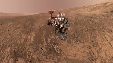 FILE - This composite image made from a series of Jan. 23, 2018 photos shows a self-portrait of NASA's Curiosity Mars rover on Vera Rubin Ridge. On Thursday, June 7, 2018, scientists said the rover found potential building blocks of life in an ancient lakebed and confirmed seasonal increases in atmospheric methane. The rover's arm which held the camera was positioned out of each of the dozens of shots which make up the mosaic. (NASA/JPL-Caltech/MSSS via AP)