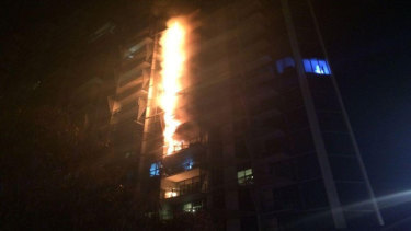 A fire caused by flammable cladding roars up the Lacrosse apartment building in Melbourne's Docklands.