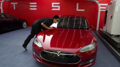 Tesla's profits disappoint, fuelling doubts about its grand ambitions