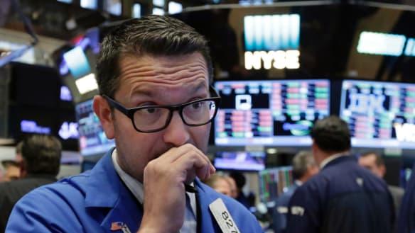 Wall Street ends losing streak as tech companies, banks shine