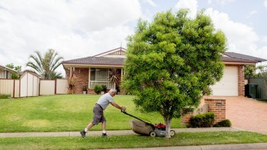 SYDNEY, AUSTRALIA - NOVEMBER 03:  Mowing the nature strip. New housing estates and construction in western Sydney.  on November 3, 2014 in Sydney, Australia.  (Photo by Michele Mossop/Fairfax Media)