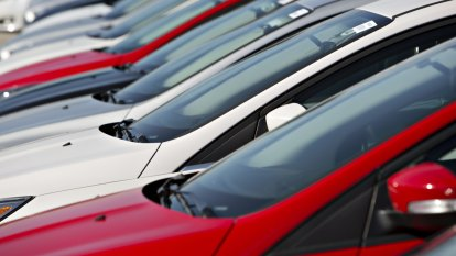 Buyers hit the brakes on new car sales last year