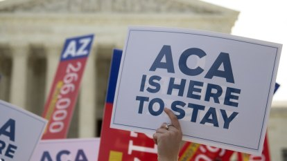 Trump administration steps up Obamacare attack, asks court to overturn law