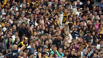Footy friends who met at Collingwood games lost more than $800k to scam