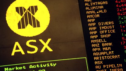 ASX scrapes higher as dovish Fed outweighs trade concerns