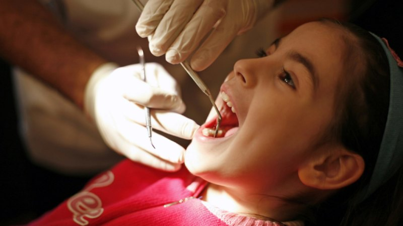 Andrews pledges free dental care for state school kids
