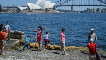 Tourists take up in Sydney Harbour at Lady Macquaries Chair.