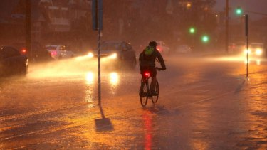 MELBOURNE, AUSTRALIA - JUNE 24: A cyclist braves the severe weather as a storm blows towards Port Melbourne on June 23, 2016 in Melbourne, Australia. A cold front moving through the state is expected to bring wild weather with snow, thunder and hail forecast and a maximum temperature of just 11 degrees. (Photo by Pat Scala/Fairfax Media)