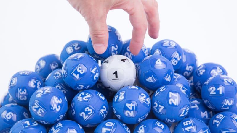 Sydney woman sets Australian lottery history with $100m Powerball windfall
