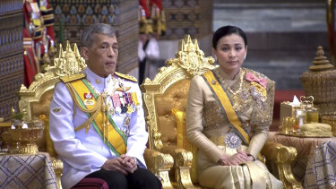 Prefers life abroad: Thailand's King Maha Vajiralongkorn, left, and Queen Suthida.