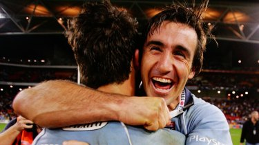Andrew Johns and Anthony Minicheillo celebrate NSW's 2005 Origin series win.