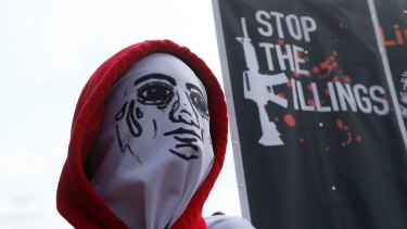 A masked demonstrator in Quezon, northeast of Manila, Philippines last year.