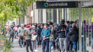People lining up for Centrelink assistance. The poor state of the economy is punching huge holes in the federal budget.