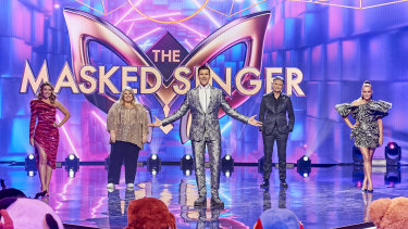 The Masked Singer's host,  Osher Gunsberg (centre), with this year's guessing panel, including Dave Hughes.