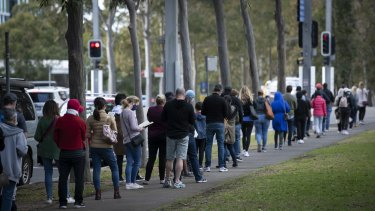 People wait in line at the mass vaccination centre at Sydney's Olympic Park this week.