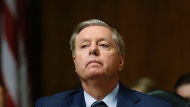 Tuning out: Republican Senator Lindsey Graham.