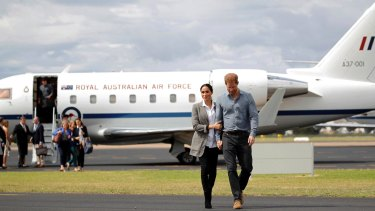 Fashion with a conscience ... Meghan wearing Outland Denim for her arrival to Dubbo with Prince Harry.