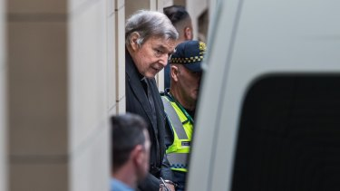 George Pell leaves the Melbourne Supreme Court after Victoria's highest court rejected his appeal in August.