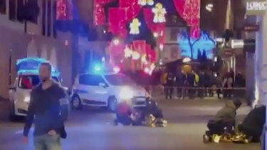 People lay on the ground after a shooting near a Christmas market in Strasbourg, France.