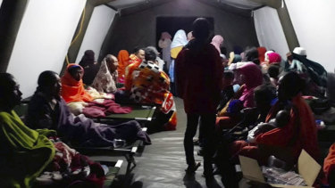 People affected by the earthquake rest at a temporary shelter in Lombok, Indonesia.