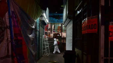 A sanitary team disinfects the Jamaica Market, which is scheduled to reopen today in Mexico City.