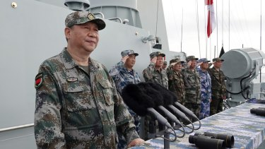 Flexing his muscles in the region. Xi Jinping speaks after reviewing the Chinese People's Liberation Army Navy fleet in the South China Sea in 2018.