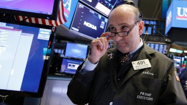 The S&P 500 and Dow Jones slid lower but the Nasdaq posted gains.