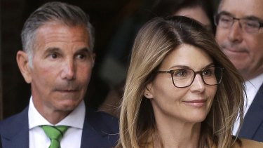Lori Loughlin and her husband Mossimo Giannulli, pictured in 2019.