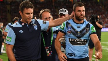 Brad Fittler consoles James Tedesco after a head knock forced him from the field in the Origin decider on Wednesday.