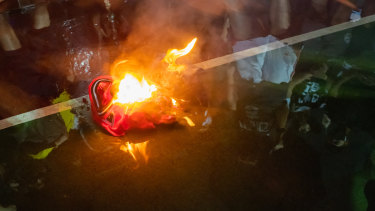 A LeBron James jersey burns during a rally in Hong Kong.