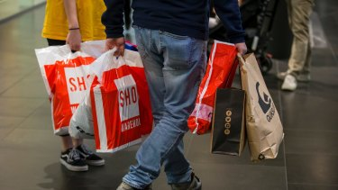 The government is urging Australians to return to the shops and spend but many remain reluctant.