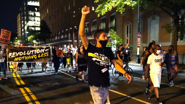 Protesters rally near the White House on the fourth day of the Republican National Convention.